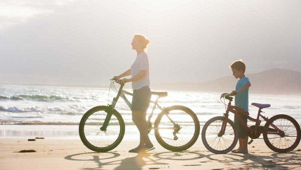 mother and son riding bikes together